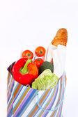 Paper bag full of vegetables — Stock Photo