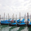 Gondolas with blue cover in Venice — Stock Photo