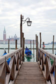 Gondola at the end of the bridge with blue cover — Stock Photo