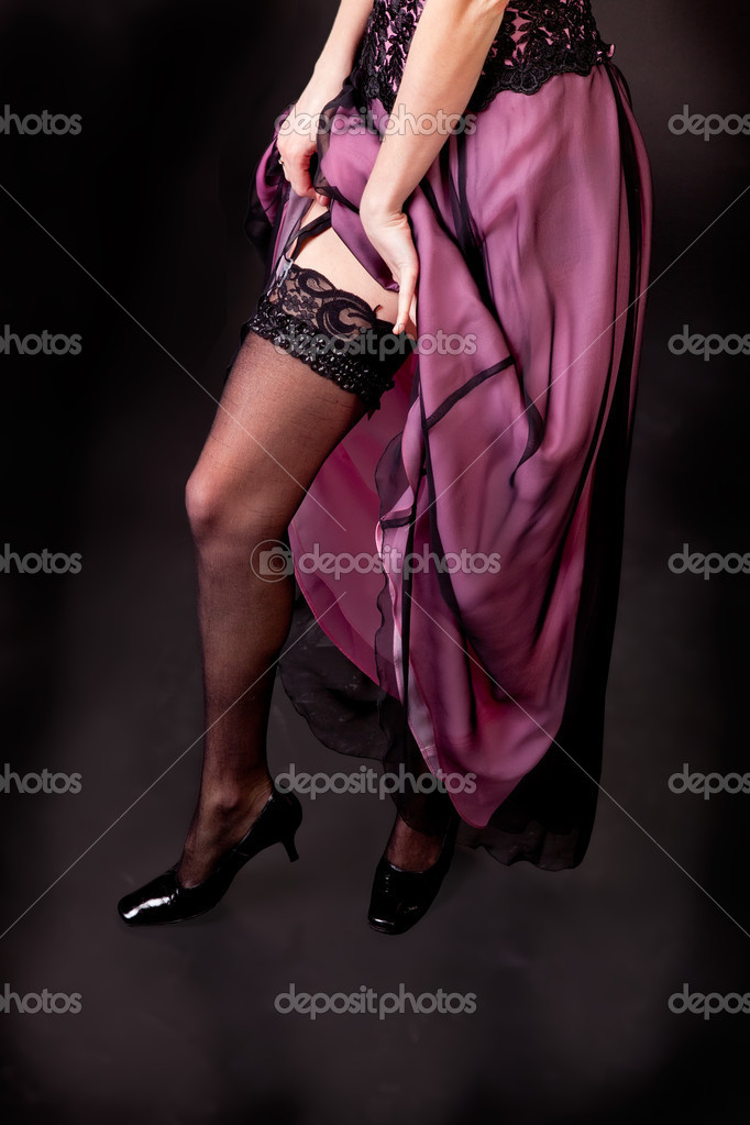 Young woman legs in stockings isolated on dark background — Stock Photo #5173201