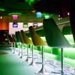Постер, плакат: Chairs in row in bar