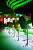 Chairs in row in bar — Stock Photo