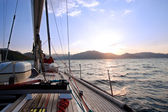 Sailing boat in the sea at sunset — Stock Photo