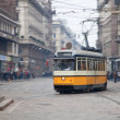 Vintage tram on the city street with motion blur — Stock Photo