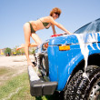 Royalty-Free Stock Photo: Girl in bikini washing car with selective focus