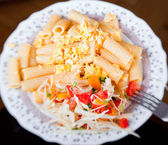Pasta with salad from tomato and cabbage — Stock Photo