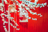 Installation of wedding hearts, sakura flowers and cages — Stock Photo