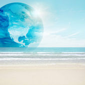 America globe on tropical beach. Map from NASA imagery — Stock Photo