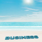 Business text on beach — Stock Photo