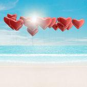Heart balloons over the sea — Stock Photo