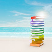 Rainbow books near beach — Stock Photo