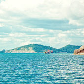 Cloudy sky and island — Stock Photo