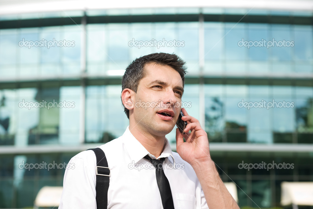 Manager speak on phone across office building  Stock Photo #4012393