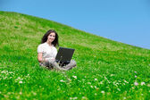 Beautiful woman with notebook on hill — Stock Photo