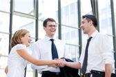 Handshake between office workers — Stock Photo