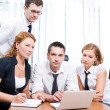 Manager with office workers on meeting — Stock Photo #4107586