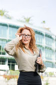 Real office worker posing for camera — Stock Photo