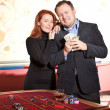 Royalty-Free Stock Photo: Happy pair with money near roulette table