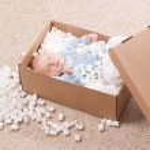 Newborn baby in open post box — Stock Photo #5133568