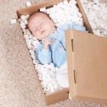 Newborn baby in open post box — Stock Photo