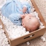 Newborn baby in open post box — Stock Photo #5133798