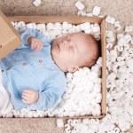 Newborn baby in open post box — Stock Photo #5133800