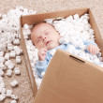 Newborn baby in open post box — Stock Photo #5133802