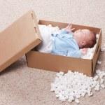 Newborn baby in open post box — Stock Photo #5133816