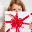 Girl with angel wings and set of gifts — Stock Photo