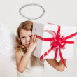Girl with angel wings and gift — Stock Photo