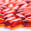 Red capsules on white background — Stock Photo #5134192