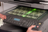 Fake money on copy machine in office — Stock Photo