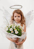 Girl with flowers and angel wings — Stock Photo