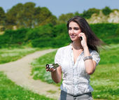 Pretty woman speaking on phone with compass — Stock Photo
