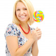 Attractive smiling blonde with lollipop — Stock Photo #4641826