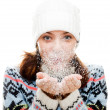 Beautiful woman blowing snow - Stock Photo