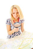 Attractive young blonde studying map and doesn't understand anyt — Stock Photo