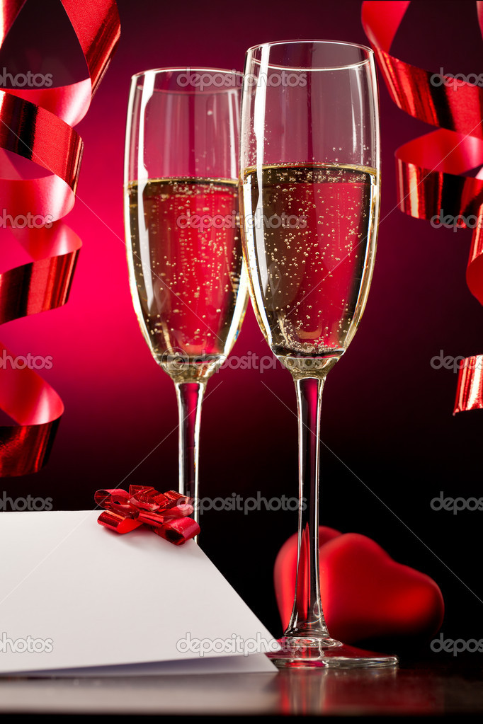 Two full glasses of champagne over red background  Stock Photo #4649367