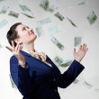 Women with flying money. — Stock Photo