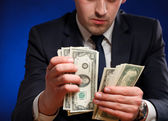 Businessman counts money — Stock Photo