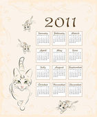 Calendar 2011 with cat and kittens — Stock Vector