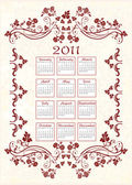 Vintage calendar 2011 with floral frame — Stock Vector