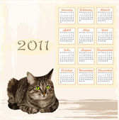 Hand drawn calendar 2011 with lying tabby cat — Stock Vector