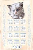 Hand drawn calendar 2011 with fluffy kitten — Stock Vector