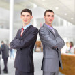 Two young businessman posing back together team portrait — Foto Stock