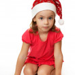 Girl in Christmas hat. — Stock Photo