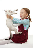 Beautiful little girl with a kitten. — Stock Photo
