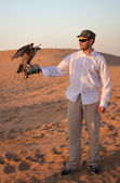 Hunter with a falcon — Stock Photo