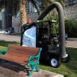 Machine for cleaning debris on lawns and sidewalks. - Stock Photo