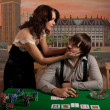 Wife persuades her husband to stop playing poker. - Stock Photo
